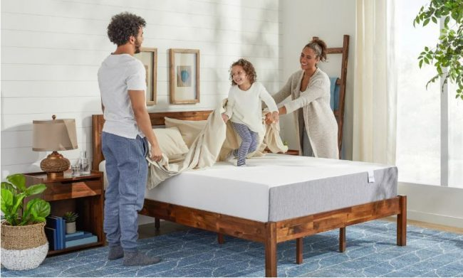 Parents gathered around the bed with a child